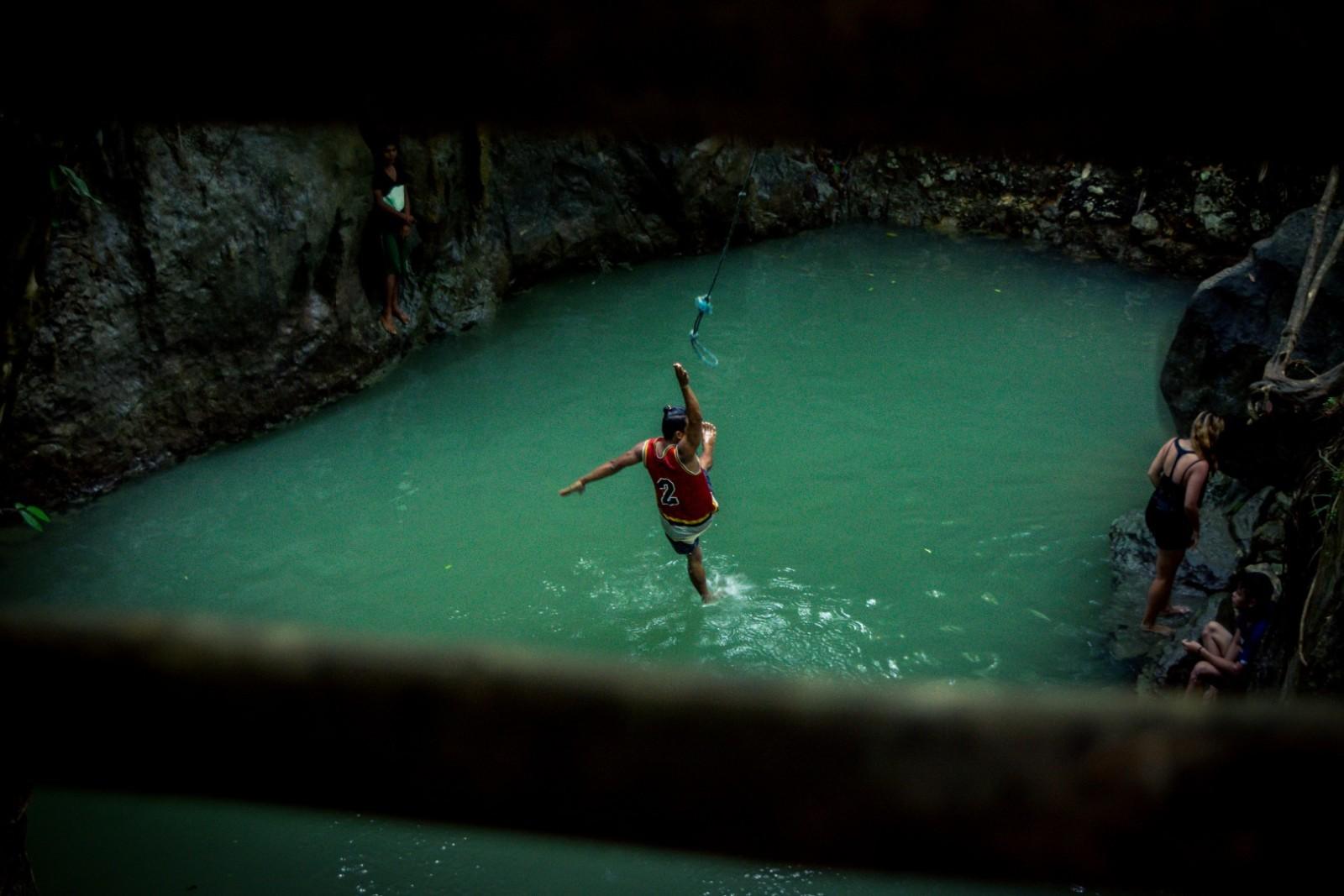 Rope swing at Tayabang cave siargao