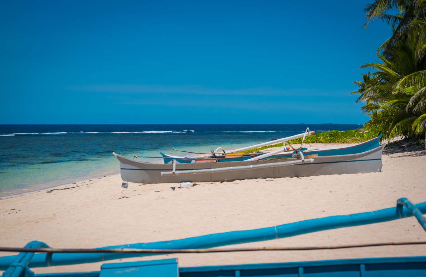 local painted boats in Pacifico Siargao