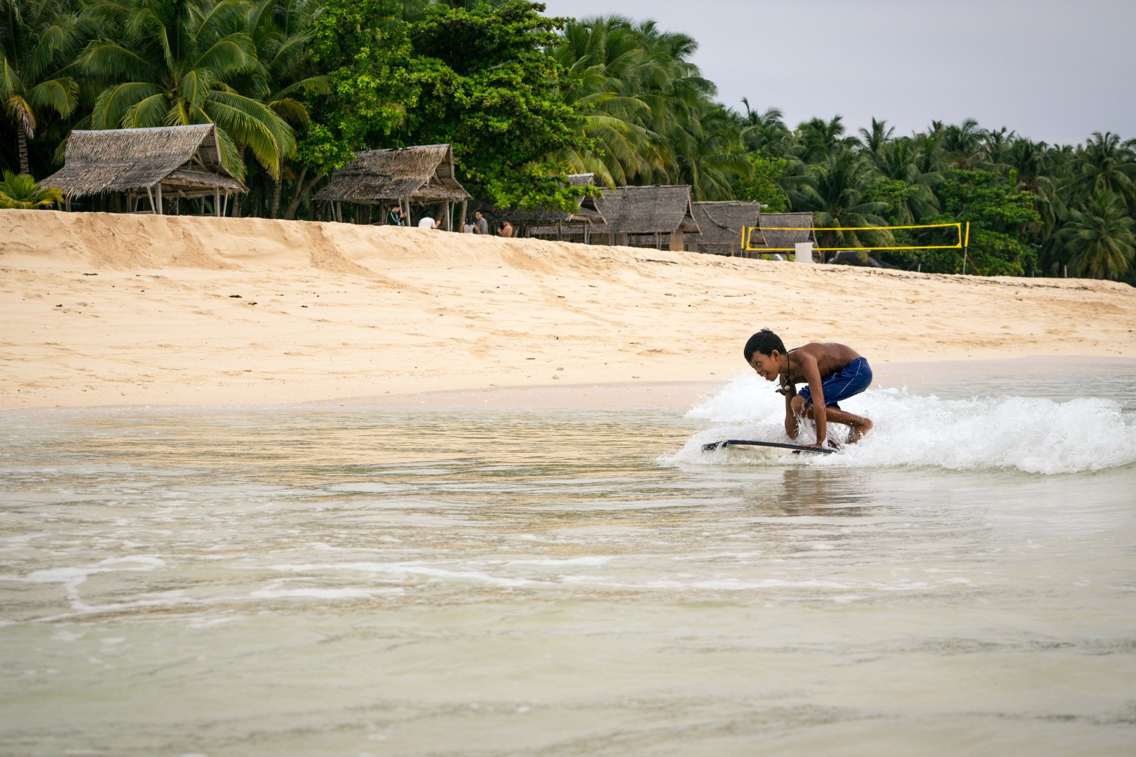 small boy surfing at Dako island Siargao